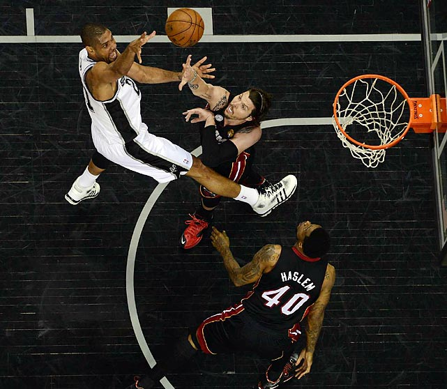 San Antonio Spurs forward Tim Duncan fights off the Miami Heat's Mike Miller and Udonis Haslem during Game 5 of the NBA Finals. Duncan scored 17 points and collected 12 rebounds to push the series to 3-2 and leave San Antonio within one game of its fourth title in 11 years.