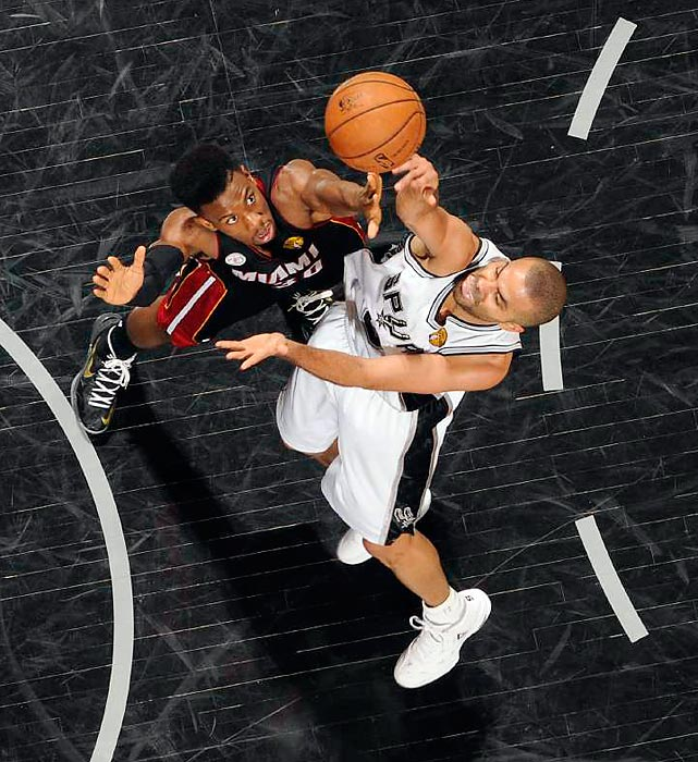 San Antonio Spurs guard Tony Parker floats a runner in the paint during Game 4 of the NBA Finals vs. the Miami Heat. Parker finished with 15 points and nine assists, but the Spurs fell to Miami, 109-93, to even up the best-of-seven series at 2-2.
