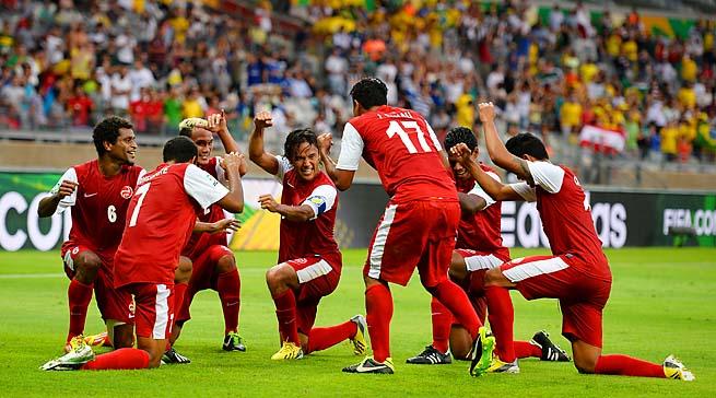 Tahiti celebrates its goal in the 54th minute by Jonathan Tehau.
