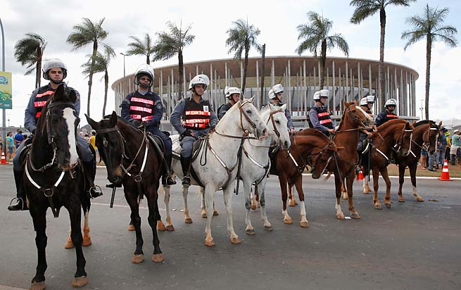 Security services patrol as protestors gather prior to the Confederations Cup opener Saturday.