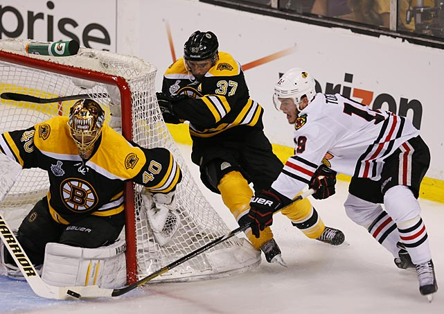 Bruins' goaltender Tuukka Rask blocks a wrap-around attempt by Blackhawks captain Jonathan Toews, who continued to struggle through a scoring drought. Toews played on two different lines, but was held scoreless for the third straight game. He's produced a mere three assists in his last nine games dating back to the second round of the playoffs.