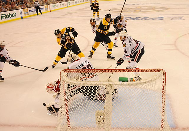 Chicago netminder Corey Crawford kicks away a shot from Boston's Patrice Bergeron. Crawford played valiantly, stopped 33 of the 35 shots he faced, but with the Hawks unable to generate any offense, he needed to be perfect.