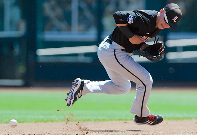 Sutton Whiting can't come up with a ground ball during the Cardinals' 11-4 loss to Oregon State.
