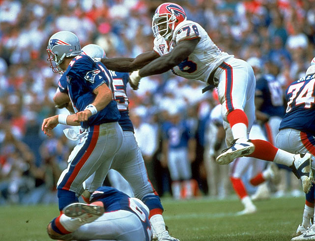 Smith leaps past blockers in pursuit of Patriots QB Drew Bledsoe.