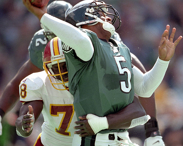 The Redskins defensive end Bruce Smith makes a sack on Eagles quarterback Donovan McNabb at Veterans Stadium.