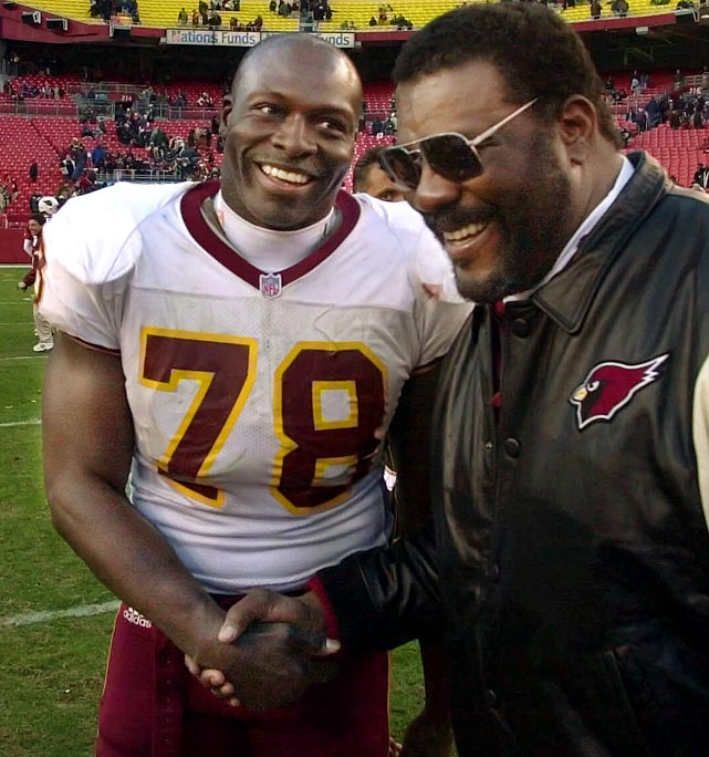 Mean Joe Greene, the Cardinals' defensive line coach, congratulates Smith after the Redskins won 20-3. Smith made his 10th sack of the season, giving him 13 seasons with double-digit sacks.