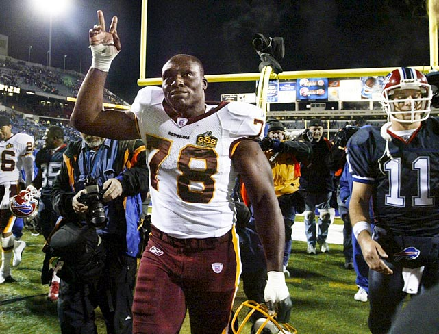 Smith waves to the crowd in Buffalo after his only game against his former team. The Redskins lost the game, 24-7.