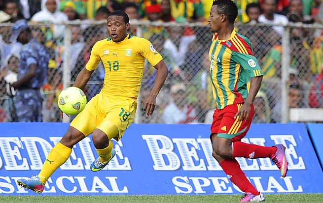 South Africa's Thuso Phala (left) controls the ball past Ethiopia's Abebaw Butako during a qualifier Sunday.