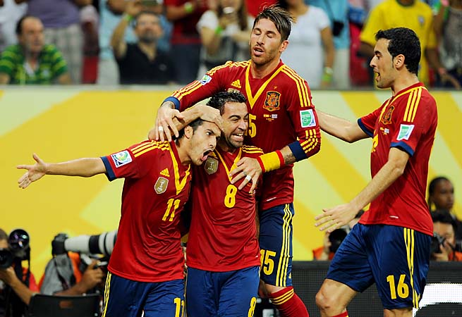 Pedro (11) celebrates after scoring the first goal in Spain's 2-1 win over Uruguay.