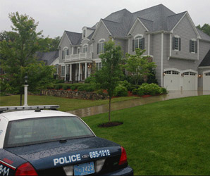 Cop cars blocked Aaron Hernandez's driveway before entering his home for questioning.