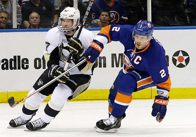 Mark Streit (right) captained the Islanders to a playoff appearance this year in which they lost to the Penguins.