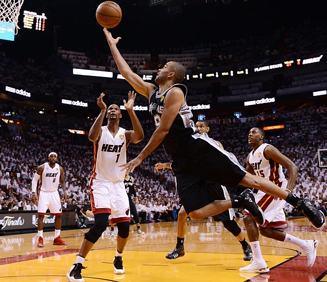 San Antonio's Tony Parker attempts a floater as the Heat's Chris Bosh (1) and Mario Chalmers (15) look on. Parker finished with 19 points and eight assists.