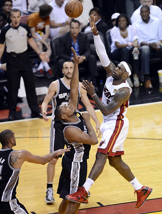 Miami's LeBron James floats a jumper over San Antonio's Boris Diaw.