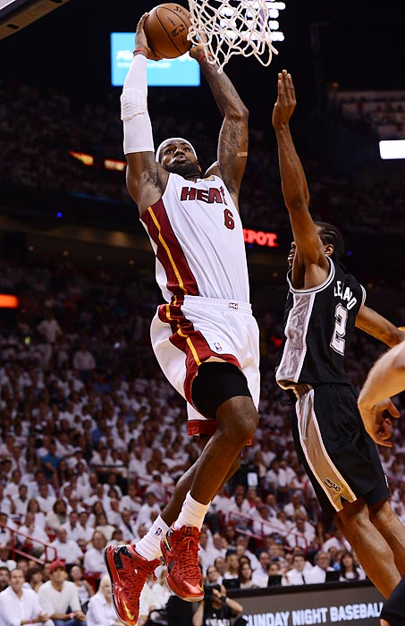 Miami's LeBron James leaps for a dunk over San Antonio's Kawhi Leonard during Game 6 of the 2013 NBA Finals. James finished with 32 points, 11 assists, and 10 rebounds for the ninth triple-double of his playoff career. The Heat won 103-100 in overtime.