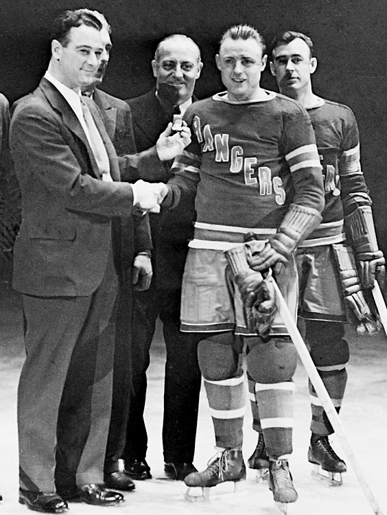 Lou Gehrig, at this point 1,307 games into his 2,130 consecutive game streak, presents a ring to the New York Rangers' Murray Murdoch in Jan. 1934, who had played in all 400 Rangers games.
