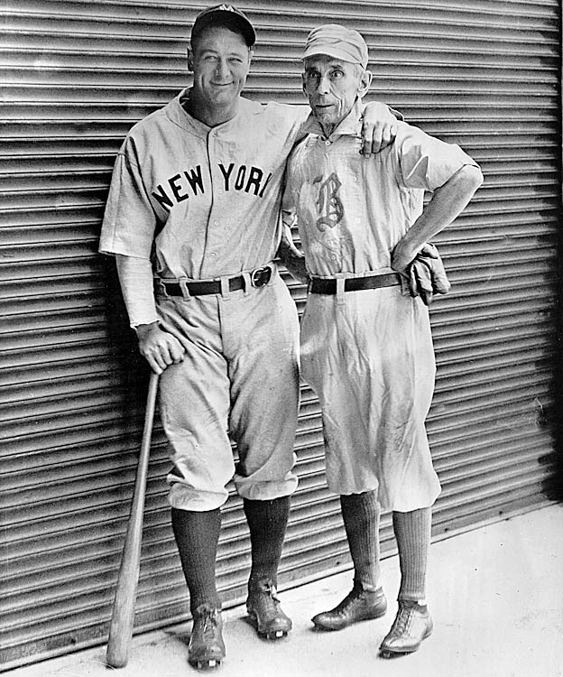 Gehrig poses with old-time Boston player Bobby Lowe on June 9, 1932, in Detroit. Gehrig matched Lowe's record of four consecutive home runs in a single game.