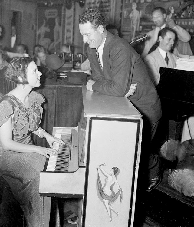 Lou Gehrig leans over the piano at a night club in Sept. 1935.