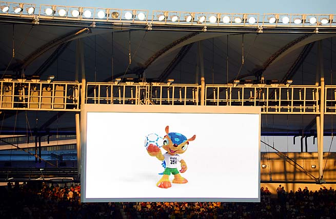The Brazil 2014 World Cup mascot Fuleco is seen on the big screen during the Confederations Cup.