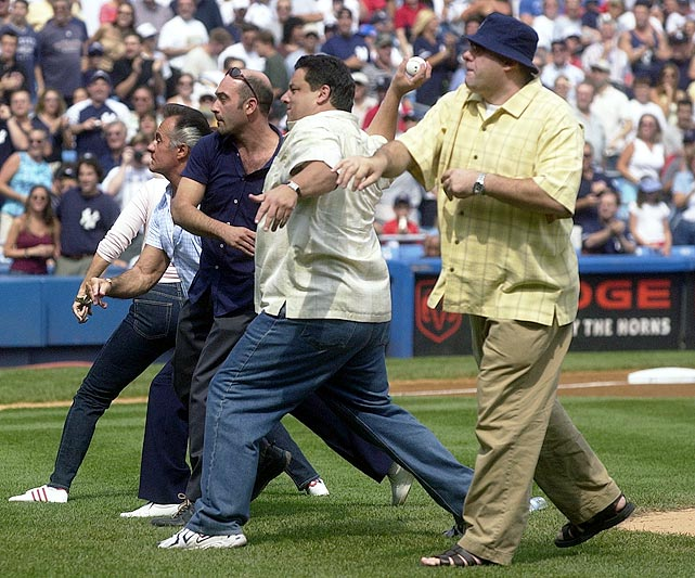 James Gandolfini throws out the ceremonial first pitch with (left to right) Lorraine Bracco, Tony Sirico, John Ventimiglia and Steve R. Schirripa before a game between the New York Yankees and the Chicago White Sox at Yankee Stadium in the Bronx, NY. The Yankees lost 8-1.