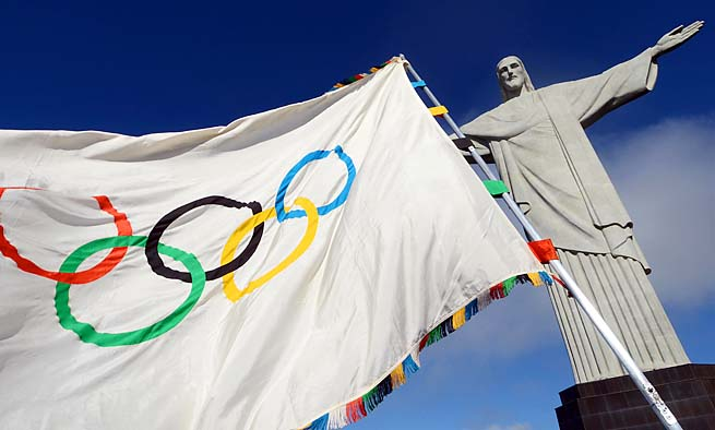 The Olympic flag flies at the Christ the Redeemer statue in Rio de Janeiro.