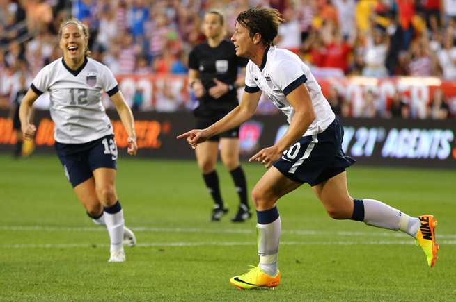 Abby Wambach celebrates after scoring her 159th career goal, breaking Mia Hamm's all-time mark.