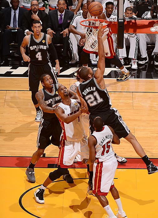 Tim Duncan attempts a layup from just under the basket. Duncan finished with 24 points and 12 rebounds, coming up one game short of his fifth NBA title.