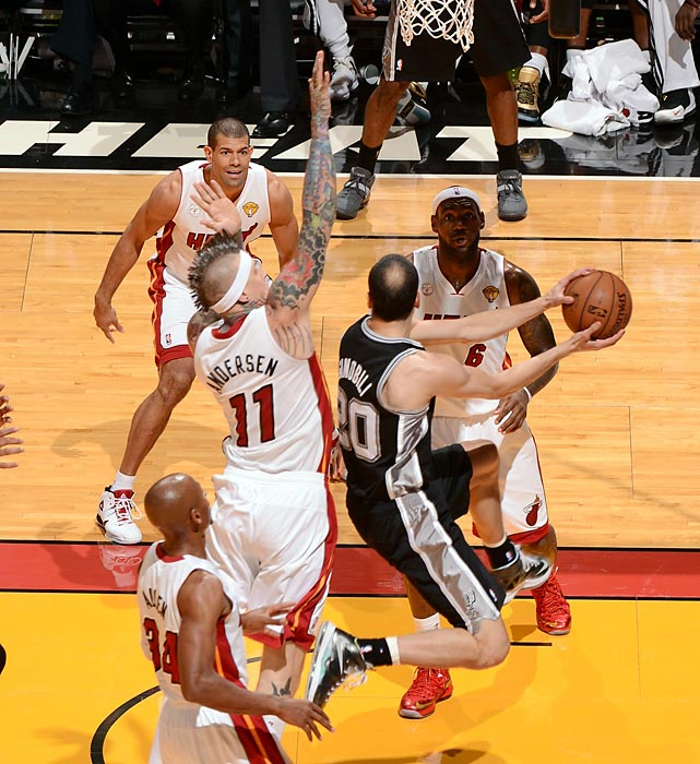 Four Heat defenders smother the Manu Ginobili.