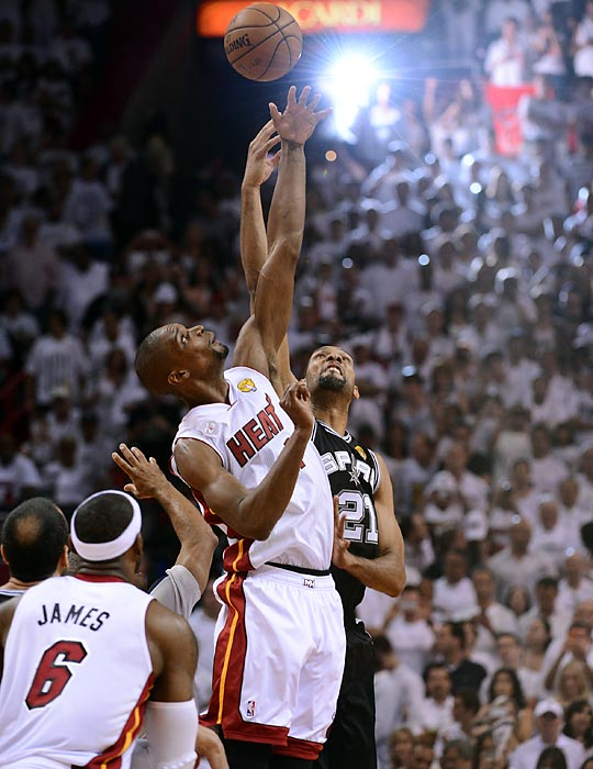 Chris Bosh and Tim Duncan jump for the opening tip of Game 7 of the 2013 NBA Finals. The Heat won 95-88 to repeat as NBA champions.