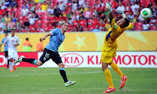 Uruguay's Diego Perez (left) scored one of Uruguay's eight goals against Tahiti.