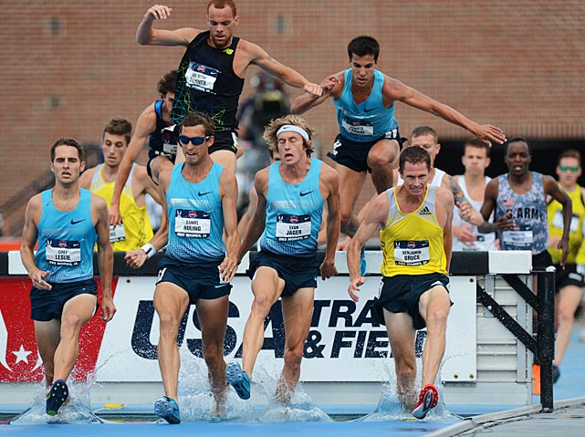 Evan Jaeger (second from right) survived a bunched up field to win the steeplechase.