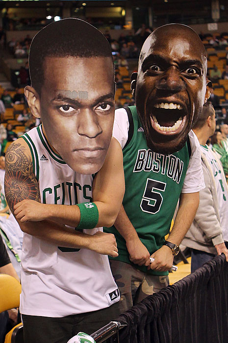 Fans wearing masks of guard Rajon Rondo and Garnett pose before a game with the Atlanta Hawks in Game 3 of the Eastern Conference quarterfinals. Garnett has adopted the city of Boston as his home since his arrival in 2007 and has become a favorite among the Celtics faithful.
