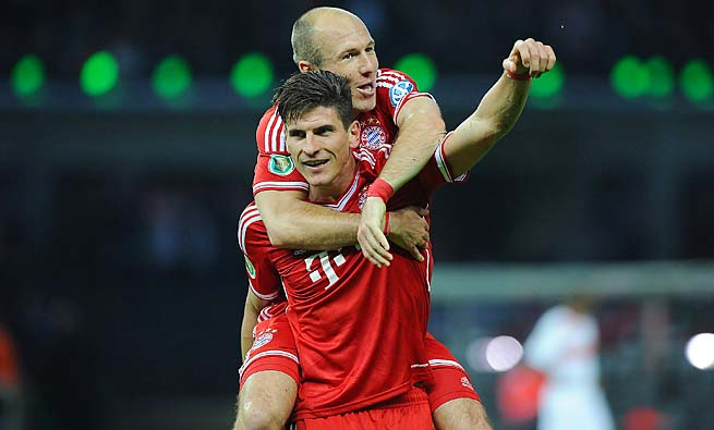 Mario Gomez and Bayern Munich won the treble this year -- German Cup, Bundesliga and Champions League.