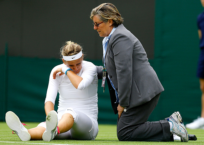 Victoria Azarenka was visibly slowed after injuring her knee, but she still managed to top Maria Joao Koehler 6-1, 6-2.