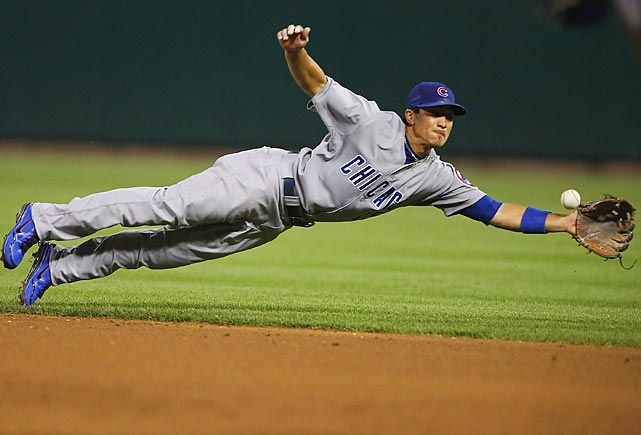 Darwin Barney of the Chicago Cubs dives to make a catch in the eighth inning vs. the St. Louis Cardinals at Busch Stadium on June 20. The Cardinals won 6-1.