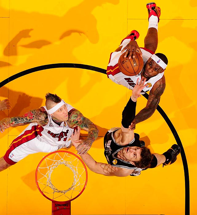 LeBron James of the Miami Heat drives to the basket in Game 6 of the NBA Finals. James finished with 32 points, 11 assists and 10 rebounds.