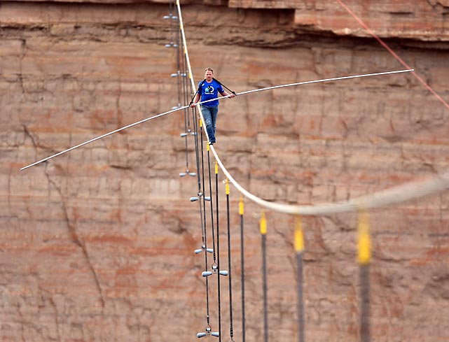 Nik Wallenda walks across a two-inch wire 1,500 feet above the ground as he crosses the Grand Canyon on June 23. It took Wallenda, who comes from a family of skywalkers, 22:54 to traverse a distance that spanned greater than four football fields.