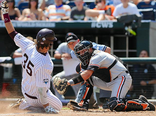Oregon State catcher Jake Rodriguez tags out Mississippi State's Wes Rea in the fourth inning of an NCAA College World Series baseball game in Omaha on June 21. Mississippi State won 4-1.