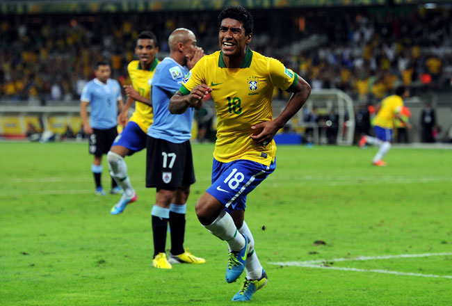 Brazilian midfielder Paulinho celebrates after scoring the game-winning goal in the 86th minute.