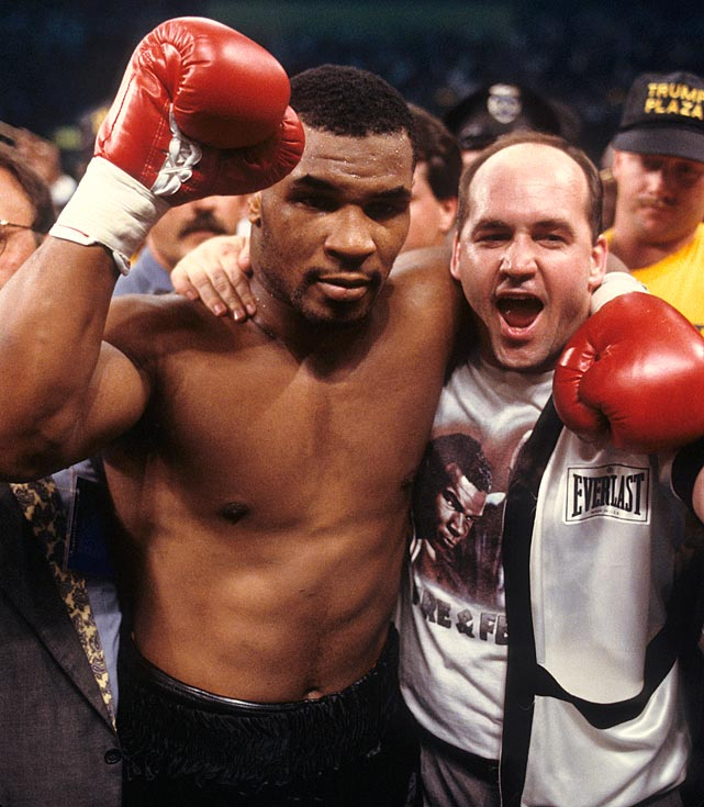 Mike Tyson celebrates with trainer Kevin Rooney after the fight.