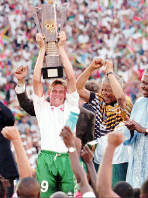 Mandela celebrates after handing the 1996 African Cup of Nations trophy to South African captain Neil Tovey.