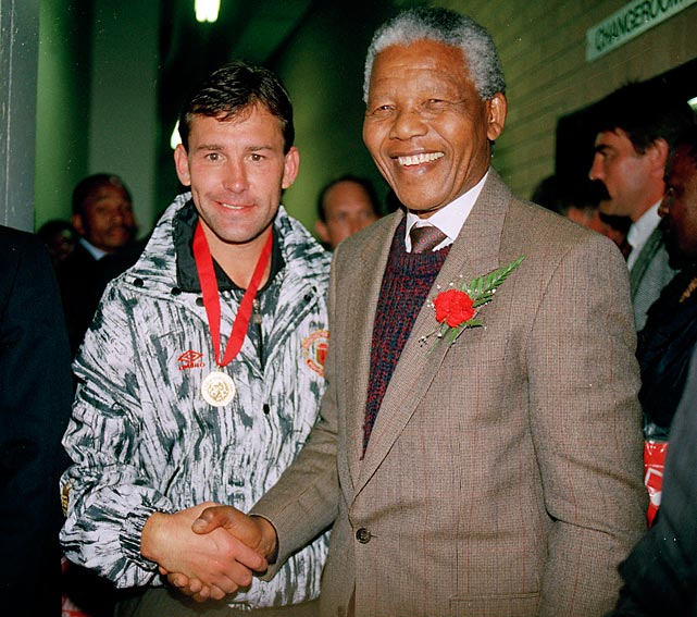Mandela with Manchester United's Bryan Robson.