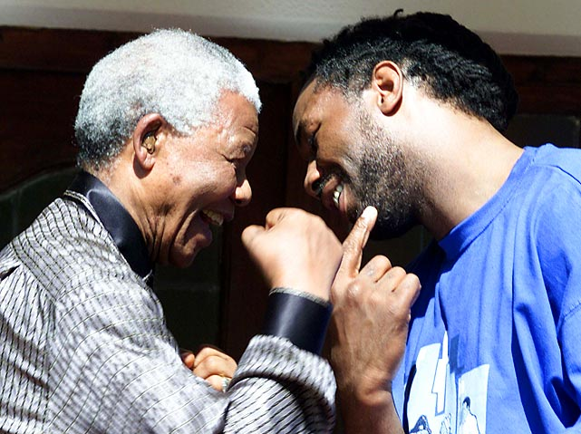 Lennox Lewis jokes around with Mandela at his home in Johannesburg.