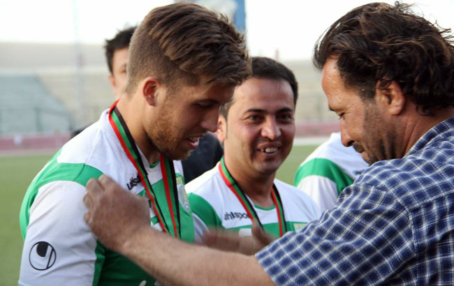 Nick Pugliese receives his medal after winning the Kabul Cup with Ferozi FC in May.