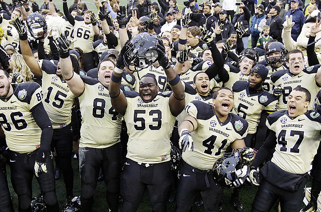 Vanderbilt players celebrated a win against NC State in the Music City Bowl for school's best season since 1915.