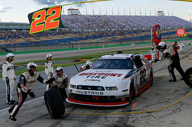 Keselowski took the lead on the 156th lap before showers halted the race for good at lap 170.