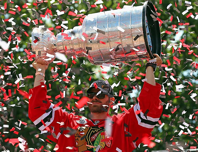 Michal Handzus of the Chicago Blackhawks lifts the Stanley Cup during the Blackhawks' championship parade on June 28.
