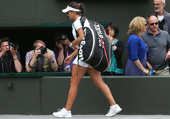 Laura Robson walks off the court after losing to Kaia Kanepi in the fourth round at Wimbledon.