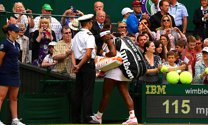 Serena Williams walks off the court after losing to Sabine Lisicki in the fourth round at Wimbledon.