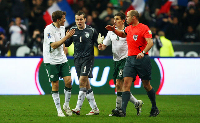 Ireland players protest to referee Martin Hansson after he allowed a goal that resulted from a handball by Thierry Henry.