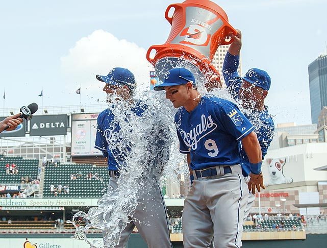 Johnny Giavotella (9) and David Lough are doused by teammate Billy Butler following the Royals 9-8 win over the Twins. Lough went 4-for-4 with a home run and three RBI in the game. Giavotella went 3-for-4 with two RBI in his season debut.